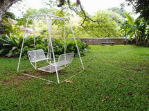 Swing in garden stock photography