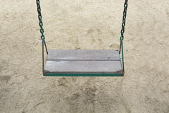 Swing in garden playground at park outdoor Stock Photo