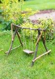 Swing in the garden. Stock Photo