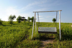 Swing in the grassland Stock Photos