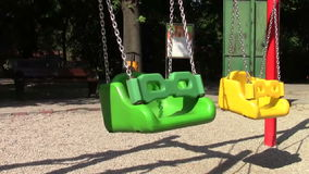 Swing. Green swing in the park stock video