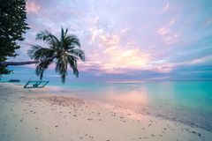 Amazing sunset beach in Maldives. Tropical landscape with dreamy sky and tropical landscape stock photo