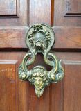 Swing handle dracula gate of the castle in Transylvania Romania. Doorknob of prince Vlad the Impaler Bran castle Romania. Bran Castle is a historical and royalty free stock photography
