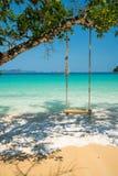 Swing hang on big tree over beach sea. Background, Nyaung Oo Phee, Myanmar Stock Images