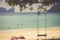 Swing hang from coconut tree over beach, Phi Phi Island, Thailan Stock Photo
