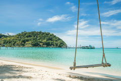 Swing hang from coconut tree over beach sea.  Travel in Phuket T Royalty Free Stock Photography