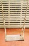 Swing hanging in garden Stock Images