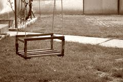 Swing hanging in yard Stock Photos