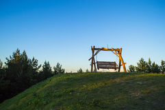 Swing. On the hill with a great view at sunset Stock Image