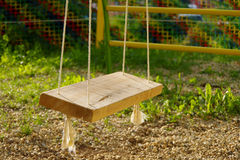 Swing. Home made wooden swing at the playground royalty free stock photography