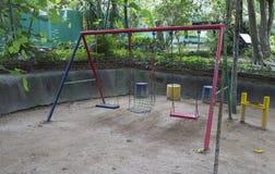 Swing in kid playground Stock Image