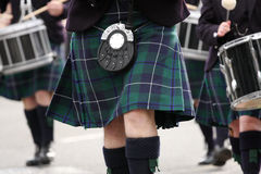 The Swing of the Kilt. A close up of a Scottish kilt and sporran on a marching musician during a pipe band performance royalty free stock photos