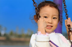 Swing little girl Stock Images