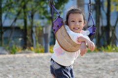 Swing little girl Royalty Free Stock Image
