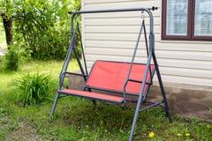 Swing near summer house Stock Photo