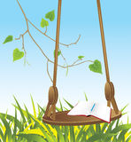 Swing and notepad with pencil Stock Images