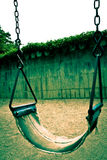 Swing. The old swing at the playground in park stock images
