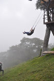Swing over the abyss in Ecuador. Casa del Arbol - Incredible swing over the abyss in Banos, Ecuador royalty free stock image