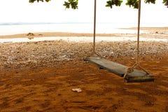Swing på stranden arkivfoto