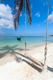 Swing, palm tree shadow, boat,  beach Stock Photography