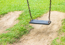 Swing in the park. With greensward Stock Image