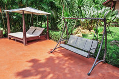 Swing on the patio in  tropical garden Stock Photography