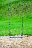 A swing in a  playground. A lonely swing in a playground Royalty Free Stock Photos