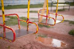 Scratched swings on the playground. stock image