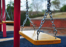 Swing on playground. Playground and swing on chains Stock Images