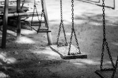 Swing in playground. Nobody sit on swing in playground Royalty Free Stock Images