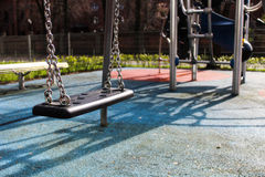 Swing on the playground Stock Images