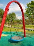 empty swing on playground Stock Image