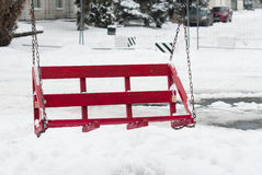 Swing of red pallets on chains Royalty Free Stock Photos