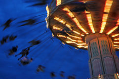 Swing Ride at the Fair. Flying Carousel at night at the county fair Royalty Free Stock Photo