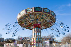 Swing Ride in Motion. Colorful swing ride in motion on a sunny afternoon at a Texas fair Stock Image