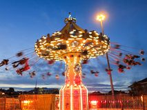 Swing Ride by night. Swing ride or chair swing ride (sometimes called a swing carousel, wave swinger, yo-yo, Chair-O-Planes or swinger) is a fairground ride that Stock Images