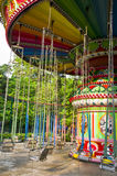 Swing rides in a children's park. Swing rides which in YueXiu Park of Guangzhou Stock Image