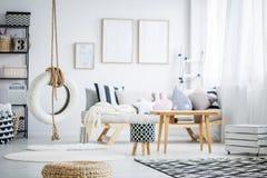 Swing in room. Simple DIY tire swing in trendy pastel scandinavian room Royalty Free Stock Image