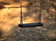 Swing in a playgroung Stock Photos