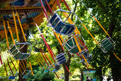 Swing seat carousel at amusement ride Stock Photography