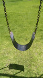 Swing seat hanging from chains Royalty Free Stock Images