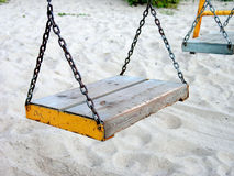Swing set. Empty swingset on a sandy beach in Estonia, Pirita Stock Image
