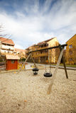 Swing Set. A swing set in a apartment block area royalty free stock photography