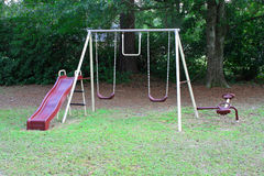 Swing set. Children's swing set in any town yard Royalty Free Stock Photos