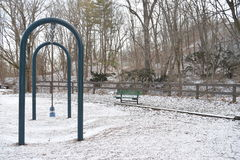 Swing set and a bench Royalty Free Stock Photos
