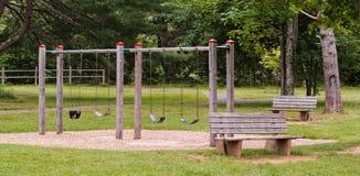 Swing Set. Children`s swing set in public park stock photos
