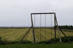 Swing set on the farm Royalty Free Stock Photo