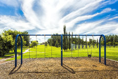 Swing Set in the Park Stock Photography