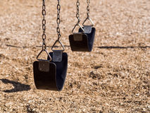 Swing set in playground stock image