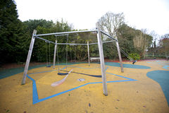 Swing set in a playground Royalty Free Stock Photos